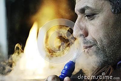 MIDDLE EASTERN MAN SMOKING HOOKAH Editorial Image