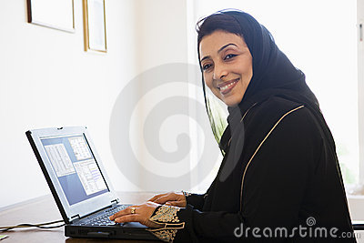 A Middle Eastern woman on a computer