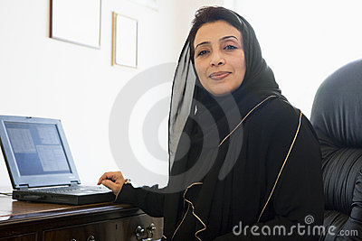 A Middle Eastern woman using computer