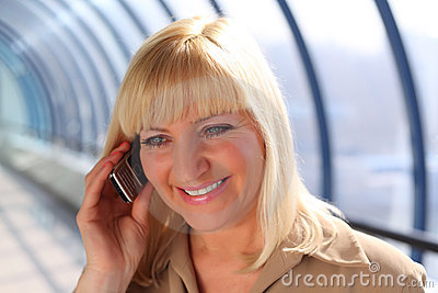 Middleaged businesswoman talks on cellular phone