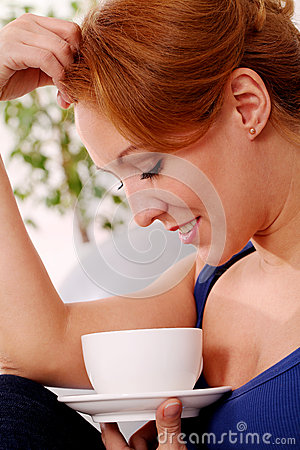 Middleaged happy woman enjoy her tea