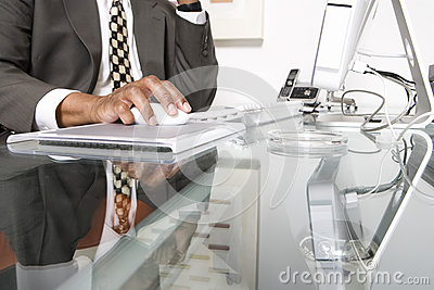 Midsection Of Businessman Using Computer