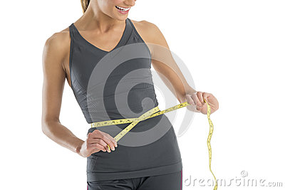 Midsection Woman Smiling While Measuring Her Waistline