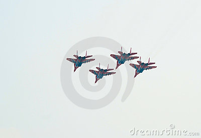 MiG-29 s (Strizhi) fly in close formation Editorial Stock Photo
