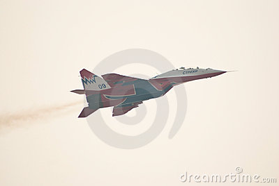 MiG-29 (Strizhi) demonstrates aerobatics Editorial Photography