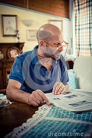 Miggle age man reading newspaper