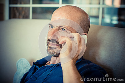 Miggle age man using phone