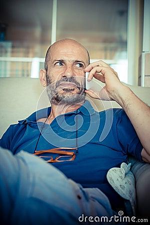 Miggle age man using phone
