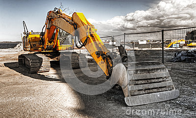 Mighty yellow excavator