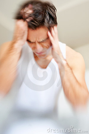 Migraine - Young man suffering from headache