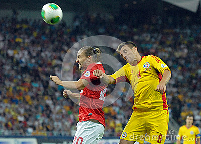 Mihai Pintilii and Caner Erkin players in Romania-Turkey World Cup Qualifier Game Editorial Stock Photo