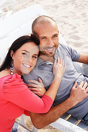Miiddle-aged couple on a beach