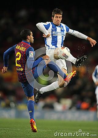 Mikel Aramburu(R) vies with Dani Alves(L) Editorial Stock Image