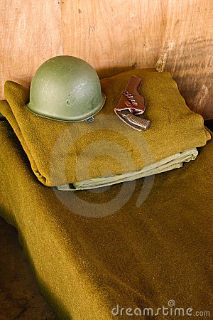 Military Bed With Helmet And Pistol Stock Photo - Image: 5757040