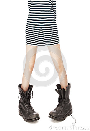 Military boots, striped singlet on woman feet
