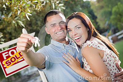 Military Couple with House Keys and Sold Real Esta