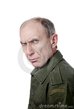 Military man staring at camera