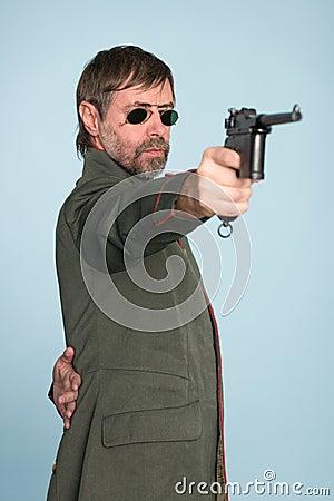 Military officer fires a gun
