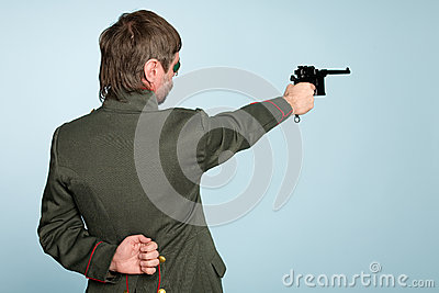 Military officer fires a gun