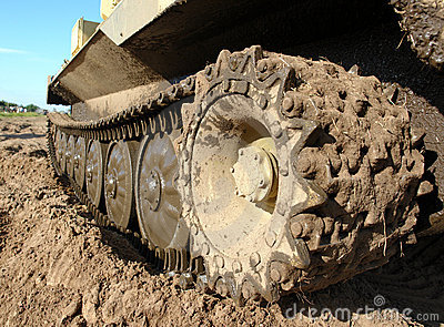 Military tank caterpillar, mudded.