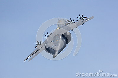 Military transport plane climbing steeply Editorial Image