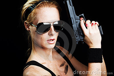 Military woman posing with gun