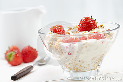Milk with cereal and strawberries