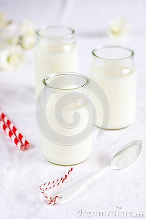 Milk jars with small spoon
