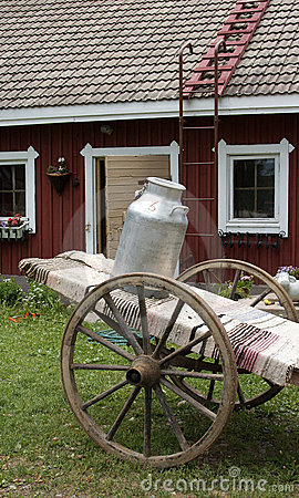 Milk jug on farm cart