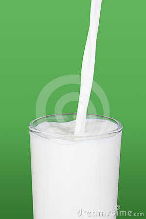 Milk pouring into a glass.