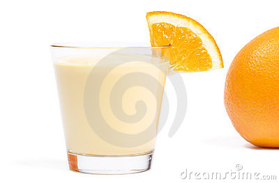 Milkshake with a piece of orange and orange in bac