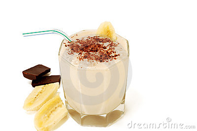 Milky banana cocktail with slices of banana and ch