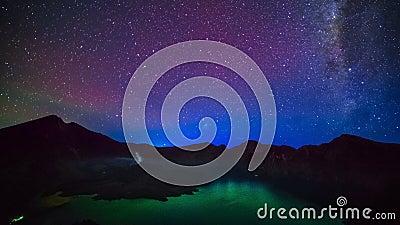 Milky way above Lake Segara Anak inside crater of Rinjani mountain on night sky. Lombok island, Indonesia. 4K Timelapse in Lombok Island, Indonesia stock video