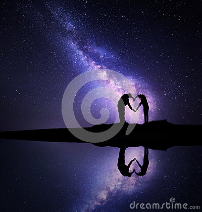 Free Milky Way. Man And Woman Holding Hands In Heart Shape Stock Image - 81645631