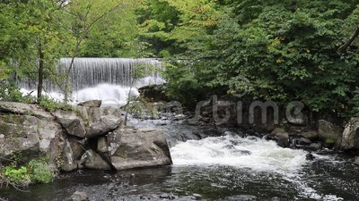 Mill Dam And Rapids On The Yamaska River In Granby, Quebec. View of rapids on the Yamaska River in Granby, Quebec, Canada, just below the remnants of a mill dam stock video