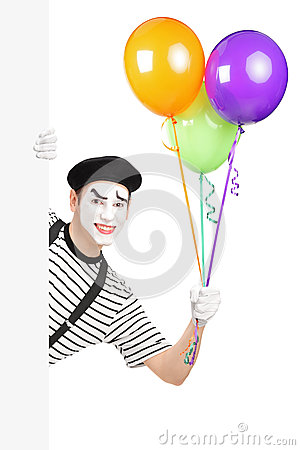 Mime artist holding a bunch of balloons and peeking from a panel