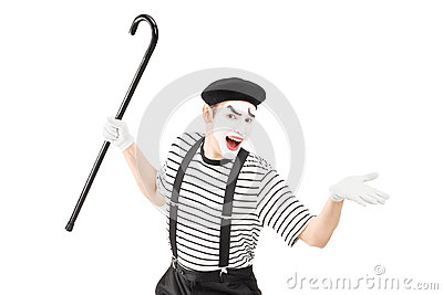 Mime artist holding a cane and gesturing