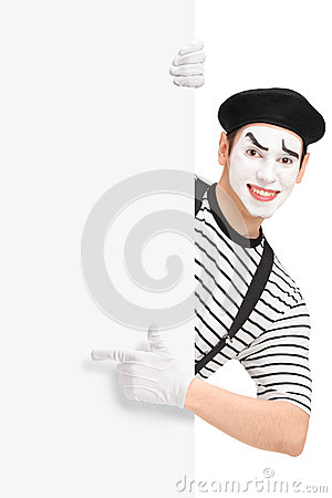Mime artist pointing on a blank panel