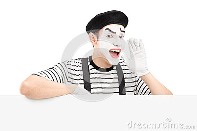 Mime dancer gesturing and shouting and standing on a panel