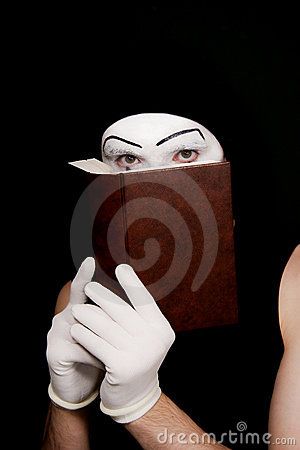 Mime in white gloves with  book