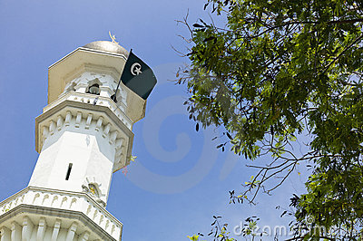 Minaret with islamic flag