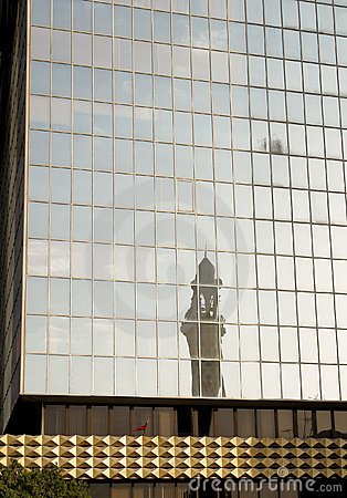 A minaret reflection from a modern building