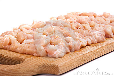 Minced chicken meat on wooden board