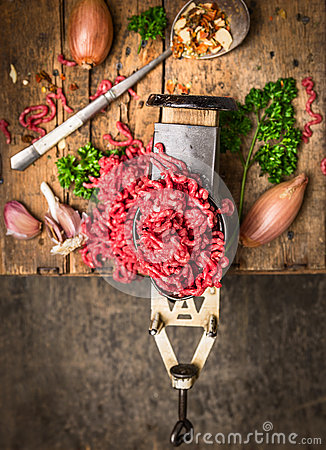 Free Minced Meat In Vintage Grinder On Background Of Herbs And Spices Royalty Free Stock Image - 46503816
