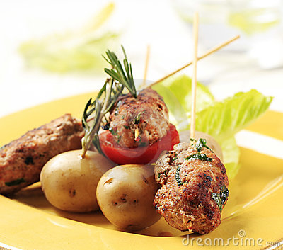 Minced meat kebabs and new potatoes