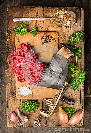 Free Mincemeat Of Vintage Meat Grinder On Old Wooden Table With Herbs And Spices In Spoon Stock Images - 46595884
