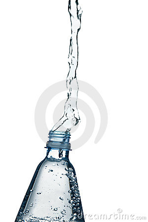 Mineral water splashing from bottle