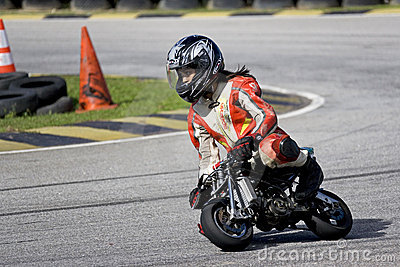 Mini Bike Championship Action - Girl Racer Editorial Photo