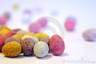 Mini candy chocolate eggs on a white surface