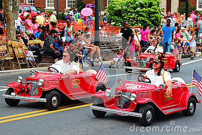 Mini Car Riders in Parade Editorial Photo